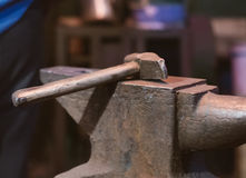 Hammer and anvil. Hammer and anvil in blacksmith`s house Royalty Free Stock Image