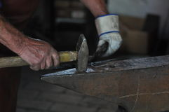 Hammer and anvil. Blacksmith working on iron at anvil Royalty Free Stock Photo