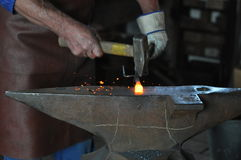 Hammer and anvil. Blacksmith working on iron at anvil Stock Photo