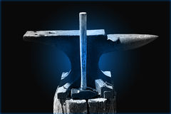 Hammer and Anvil On Blue Royalty Free Stock Photo