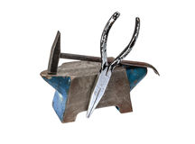 Hammer, anvil and pliers Royalty Free Stock Image