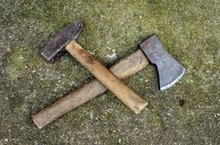 Hammer and axe Stock Image