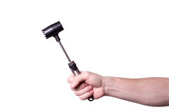 Hammer for beating the meat in the hand of men. Isolated on white background Royalty Free Stock Image