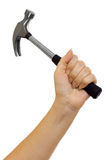 Hammer in a beautiful female hand Royalty Free Stock Photos