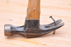 Hammer and Bent Nail Stock Images