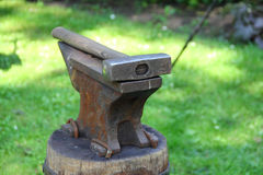 Hammer on blacksmith anvil Royalty Free Stock Photography