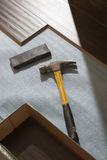 Hammer and Block with New Laminate Flooring Royalty Free Stock Images