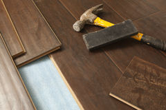 Hammer and Block with New Laminate Flooring. Abstract royalty free stock photos