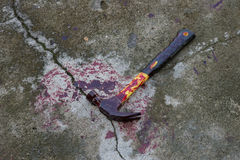 Hammer with blood Stock Photo