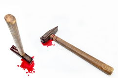Hammer with blood on white background stock photos