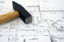 Hammer on a blueprint. Royalty Free Stock Photo