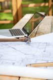 Hammer And Blueprint With Laptop At Construction Royalty Free Stock Photography