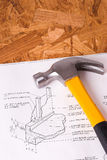 Hammer and Blueprints on Table Stock Images