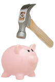Hammer Breaking a Piggy Bank Royalty Free Stock Photos
