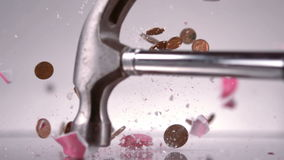 Hammer breaking a piggy bank stock footage