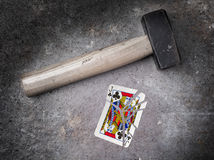 Hammer with a broken card, jack of clubs Royalty Free Stock Photos