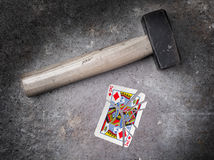 Hammer with a broken card, king of diamonds. Hammer with a broken card, vintage look, king of diamonds Stock Photography
