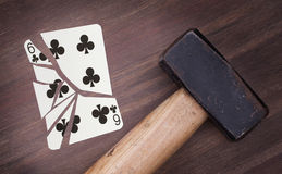Hammer with a broken card, six of clubs Stock Photos