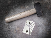 Hammer with a broken card, two of spades Stock Image