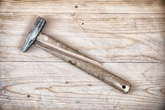 Hammer with a broken handle. Broken hammer. Hammer with a broken handle on a wooden background Stock Images