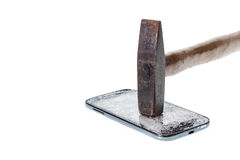Hammer and broken smart phone isolated on white background. Close up hammer and broken smart phone isolated on white background stock photo