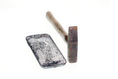 Hammer and broken smart phone isolated on white background. Close up hammer and broken smart phone isolated on white background royalty free stock image