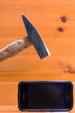 Hammer brokes mobile phone Royalty Free Stock Image