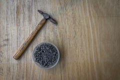 A hammer and a bucket of nails. Stock Photo