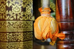 Hammer for buddhist gong hanged on temple door... Stock Image