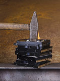 Hammer on burning hard disk Stock Photos