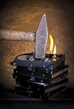 Hammer and burning hard disks Stock Image