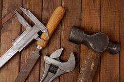 Hammer, caliper, file and wrench. Old tools. Close up af old retro tools royalty free stock photo