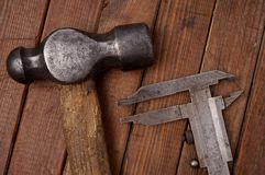Hammer and caliper. Old tools Royalty Free Stock Images