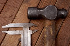 Hammer and caliper. Old tools Stock Photography