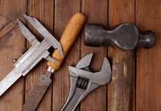 Hammer and caliper. Old tools. Close up af old retro tools Royalty Free Stock Image