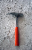 Hammer on cement Royalty Free Stock Image