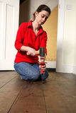 Hammer and chisel. Woman using a hammer and chisel Stock Photography