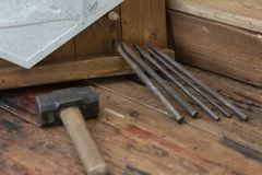 Hammer, Chisel and Cutting Wood Equipment on Wooden Plank Royalty Free Stock Images
