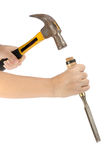 Hammer and chisel. Hand hold hammer and chisel isolate on white background royalty free stock photography