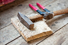 Hammer and claw tools wooden board Stock Photography