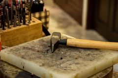 Hammer and tools for leather working royalty free stock photos