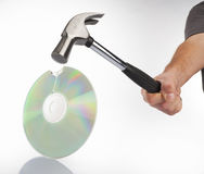 Hammer and compact disk Royalty Free Stock Photo