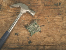 Hammer and computer chip Royalty Free Stock Images