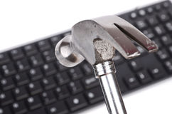 Hammer and computer keyboard Royalty Free Stock Photos