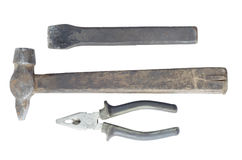Hammer and construction chisel with pliers. Old hammer and building chisel with pliers on white isolated background royalty free stock photos