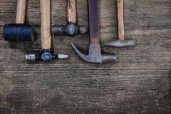 Hammer craftsman tool on wooden table, vintage style Royalty Free Stock Image