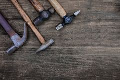 Hammer craftsman tool on wooden table, vintage style Stock Image