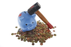 Hammer crush piggy bank. To fetch the nest egg Stock Photography