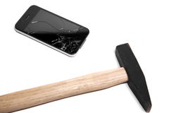 Hammer destroy the smart phone. white background. Hammer destroy the smartphone. white background stock images