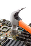 Hammer destroying motherboard Royalty Free Stock Images